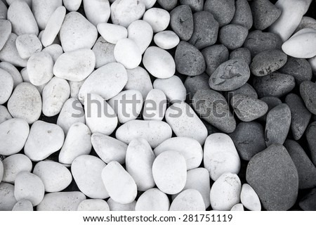 Background of black and white pebbles. Toned. - stock photo