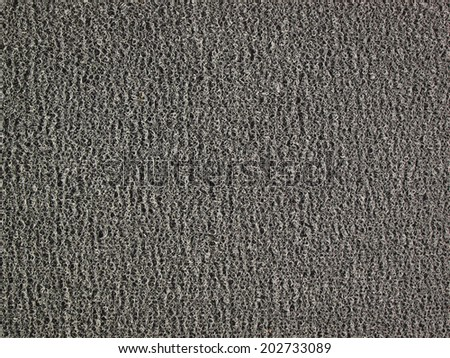 Background of black carpet or foot scraper or door mat texture