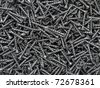 Background of black drywall screws - stock photo