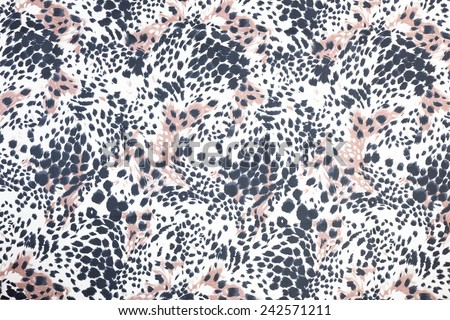 Background of black spotted animal fur print - stock photo