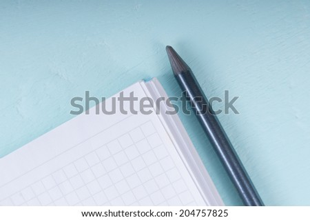 Background of blank notebook, pencil and mint on a wooden surface