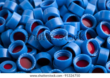 Background of blue and red carved plastic caps for chromatographic vials. - Please see my portfolio for similar images - stock photo
