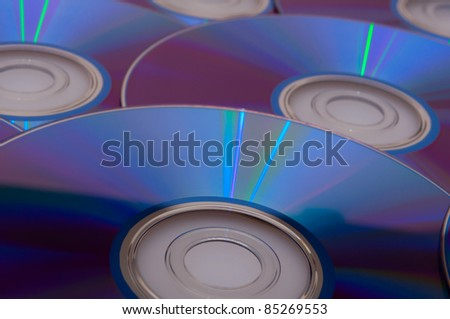 Background of Blue Glowing CD Compact Discs - stock photo