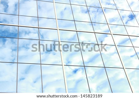 background of blue sky reflect on glasses from modern business building - stock photo