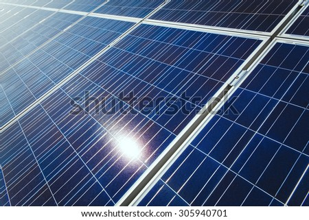 Background of Blue Solar Panels with reflection of sun