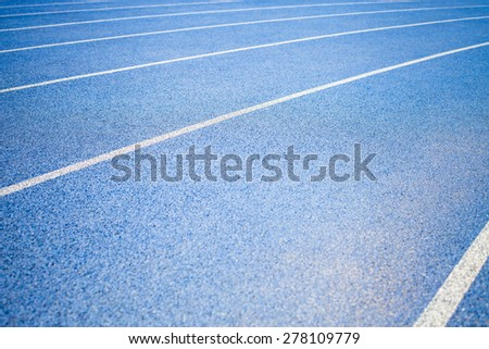 background of blue track for running competition at stadium - stock photo