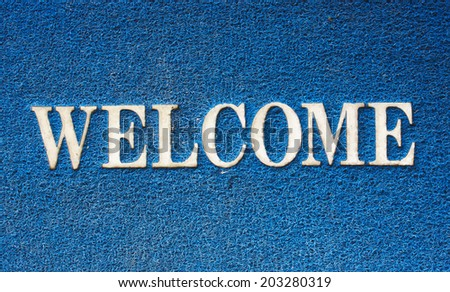 background of blue welcome carpet - stock photo