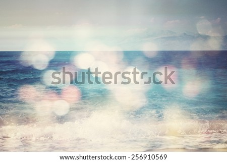 background of blurred beach and sea waves with bokeh lights, sandy beach  with turquoise water, bright white sun lights bokeh, travel and summer holidays concept, vintage effect - stock photo