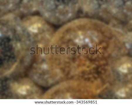 Background of blurred glass christmas balls in gold and silver - stock photo