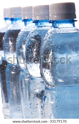 background of bottles with water - stock photo