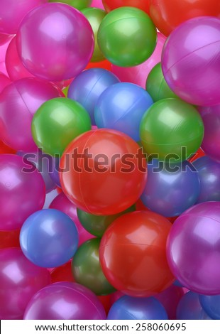 background of brightly colored plastic balls for children - stock photo