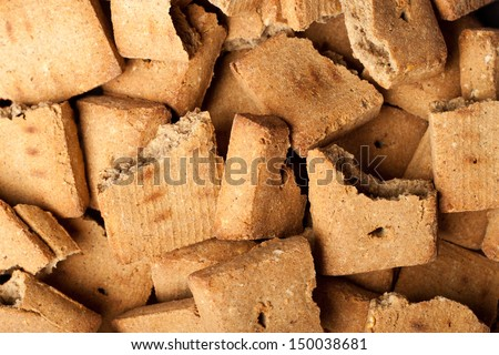 Background of broken dog treats - stock photo