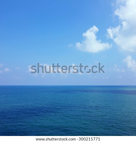 Background of calm sea and blue sky - stock photo
