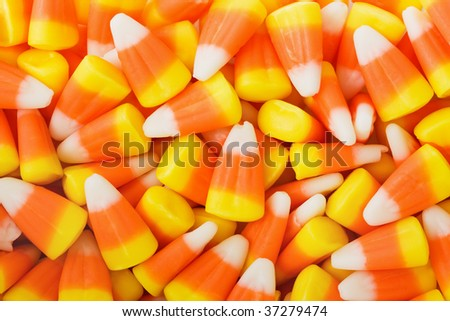 background of candy corn for autumn and Halloween - stock photo