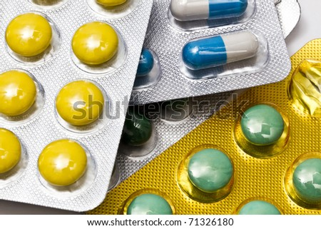 Background of capsules and pills closeup