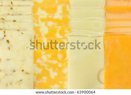 background of cheese tray slices in a vacuum package - stock photo
