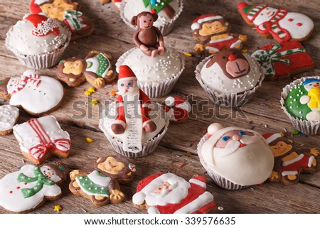 Background of Christmas sweets closeup on a wooden table. horizontal