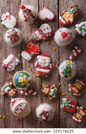 Background of Christmas sweets closeup on a wooden table. vertical top view - stock photo