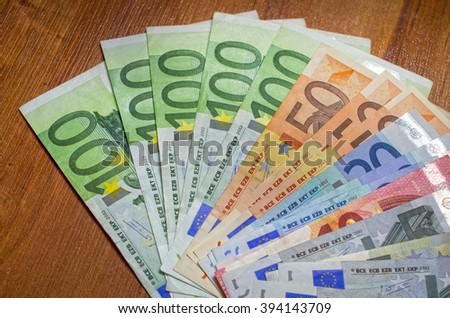 Background of Close up euro and dollars different  denomination - stock photo