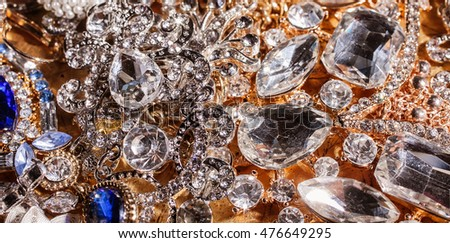 Background of close up of beautiful luxury golden jewelry