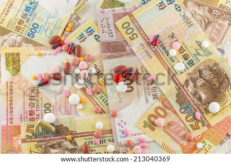 Background of closeup Hong Kong Dollar and pills medicine - stock photo