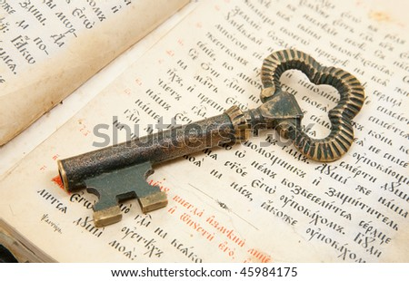 Background of Closeup of key placed on an 18st century vintage bible - stock photo