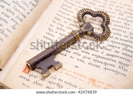 Background of Closeup of  key placed on an 18st century vintage book - stock photo