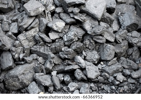background of coal pieces on a stock pile - stock photo