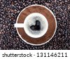 Background of coffee grains and a cup of coffee - stock photo