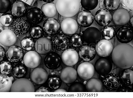 Background of colored Christmas tree balls and decorations black and white - stock photo