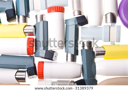 Background of Colored plastic inhalers - stock photo
