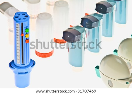 Background of Colored plastic inhalers and PEF Equipment - stock photo