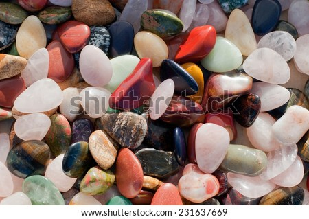 Background of colorful beach pebbles of different shape and size - stock photo