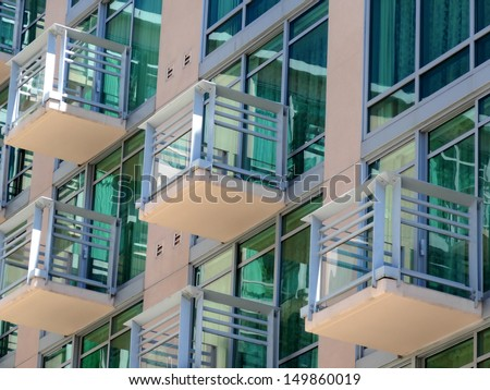 Background of colorful facade with balconies - stock photo