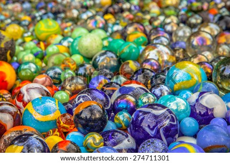 Background of colorful glass marbles as a metaphor for diversity - stock photo