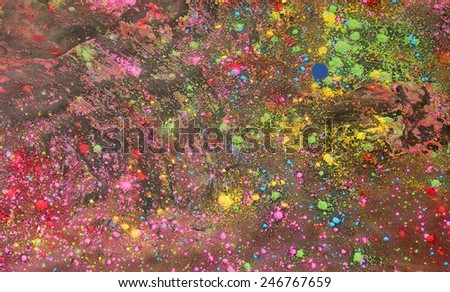 Background of colorful Holi powder in multiple colors lying scattered on the ground after the Hindu Spring festival and celebration of Holi - stock photo