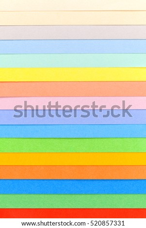 Background of colorful paper,multicolored  parallel horizontal stripes, place for text