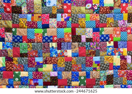 Background of colorful patchwork fabrics - stock photo