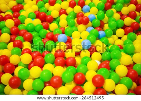 Background of colorful plastic balls in children park - stock photo