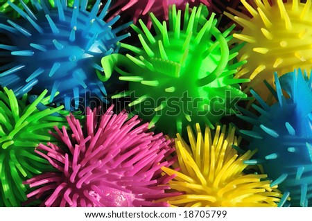 Background of colorful soft spiny rubber fish toys