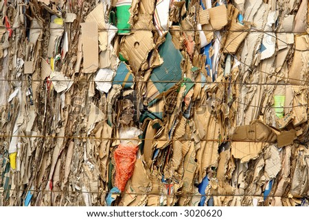 Background of compressed and wired assorted package waste paper - stock photo