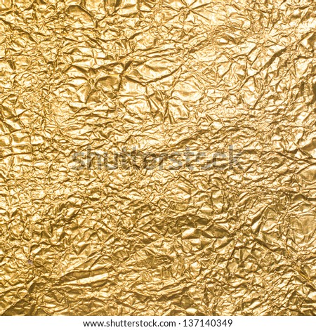 Background of crumpled gold foil - stock photo