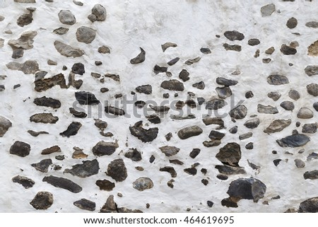Background of damaged lime-wall with stones
