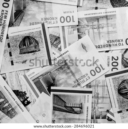 Background of Danish currency,money kroner on black and white color - stock photo