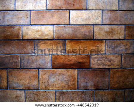 Background of dark brown brick wall. - stock photo