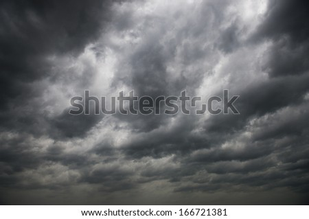 Background of dark clouds before a thunder-storm. - stock photo