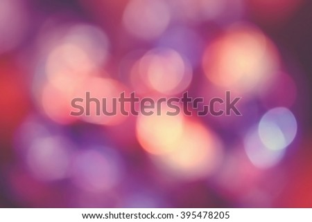 Background of defocused bokeh lights different colors - stock photo
