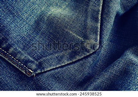 Background of denim blue color with scuffs items - stock photo