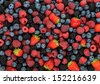 Background of different berries and fruits - stock photo