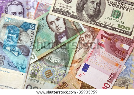 Background of different european and american currencies. View from above. - stock photo